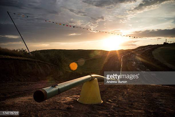 Sections of pipe wait to be welded together and placed into the ground sit in preparation on July 28 2013 outside Watford City North Dakota North...