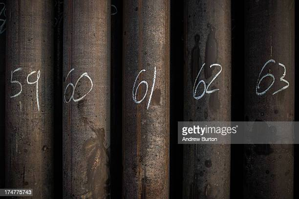 Sections of pipes are lined up before being used to drill at Raven Drilling's oil rig on July 28 2013 outside Watford City North Dakota North Dakota...