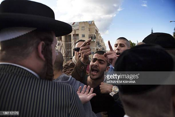Secular Israelis argue with ultra Orthodox Jewish protesters in the central town of Beit Shemesh near Jerusalem on December 26 2011 Extra Israeli...