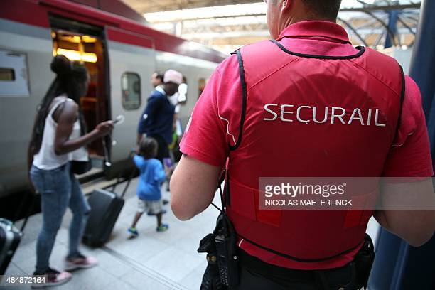 A Securail railway security agent stands on the platform at the ZuidMidi railway station in Brussels on August 22 a day after a shooting occurred on...