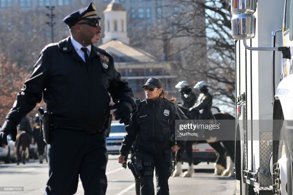 A secure perimeter is set as protestors and tourists gather ahead of the arrival of the Vice-Presidential Motorcade at Independence Mall, in Center City, Philadelphia, PA, on February 4th, 2017. VP Mike Pence is scheduled to pay a visit to the Federal Society, that day.