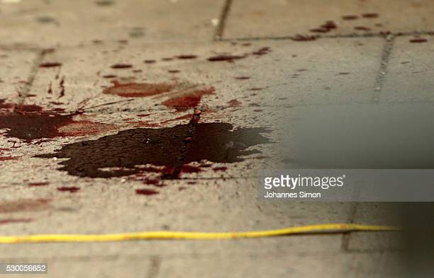 Secured by forensic specialists of the German police blood is spread on the floor at the crime scene after a deadly knife attack on May 10 2016 in...