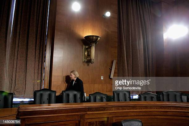 Securities and Exchange Commission Chairman Mary Schapiro prepares to testify before the Senate Banking Housing and Urban Affairs Committee about...
