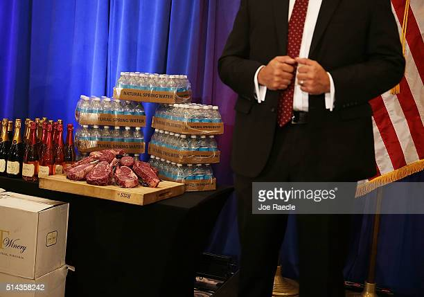 A security agent stands near a display of products that Republican presidential candidate Donald Trump has for guests including meat wine and water...