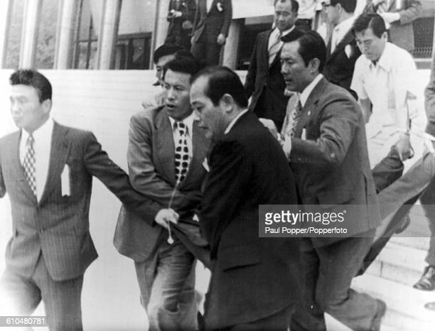Security agents carry Mun Segwang out of the National Theatre in Seoul after his failed assassination attempt on South Korean President Park Chunghee...