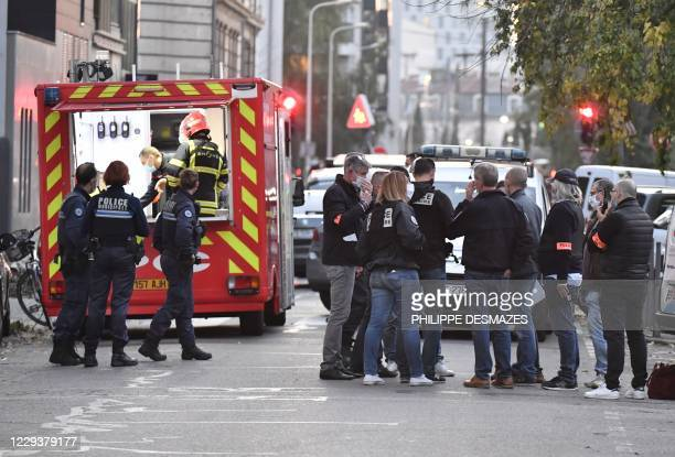 Security and emergency personnel are on October 31, 2020 in Lyon at the scene where an attacker armed with a sawn-off shotgun wounded an Orthodox...