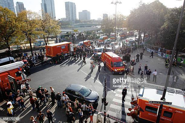 Security and firemen are seen after a fire at Maison de la Radio on October 31 2014 in Paris France Radio programs were interrupted as staff were...