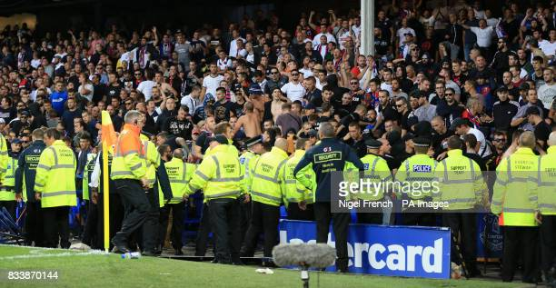 Security and Police close round Hajduk Split fans during the UEFA Europa League PlayOff First Leg match at Goodison Park Liverpool