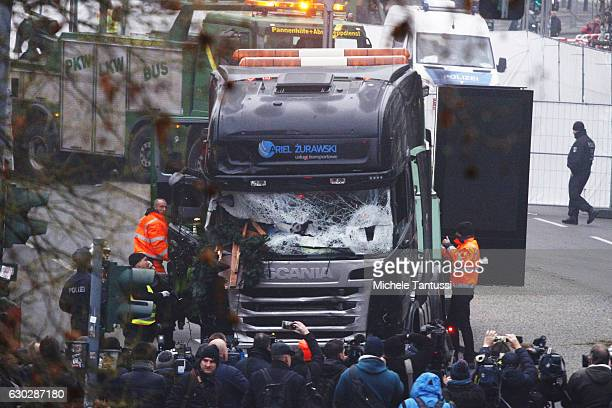 Security and rescue workers tend to the area after a lorry truck ploughed through a Christmas market on December 20 2016 in Berlin Germany So far 12...