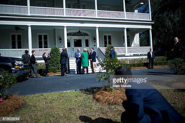 Security and staff members gather around center Democratic Presidential candidate former Secretary of State Hillary Clinton is greeted by left the...