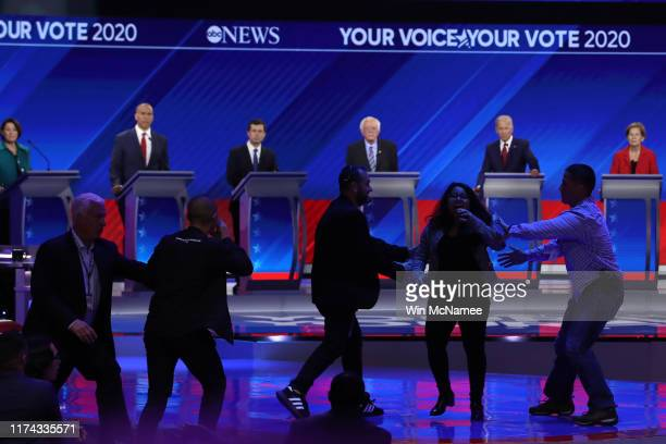 Security apprehends protesters during the Democratic Presidential Debate at Texas Southern University's Health and PE Center on September 12 2019 in...