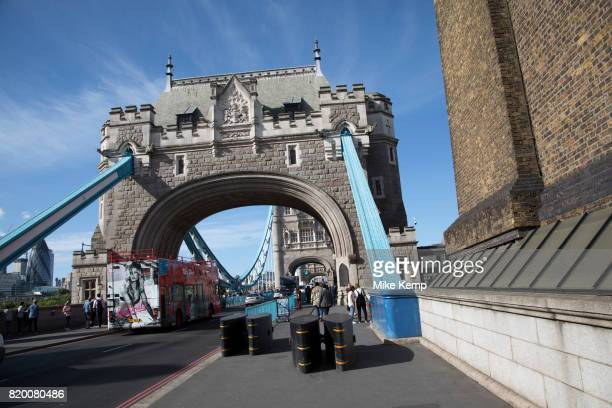 Security barricades placed on the pavement blocking Tower Bridge from any potential terror attack in London England United Kingdom Following recent...