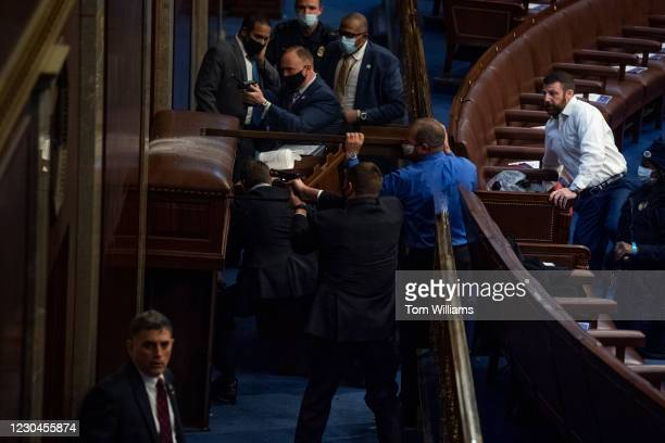 Security barricades the door of the House chamber as protesters try to break in to the joint session of Congress tcertifying the Electoral College...