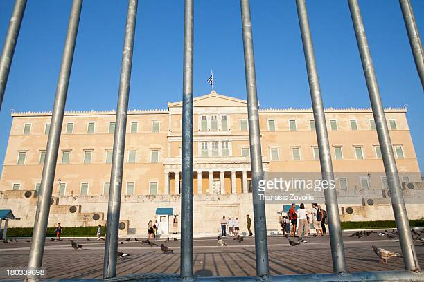 Security barriers have been placed in front of the Greek Parliament to avoid riot after the announcement of new measures on 10 August 2013 in Athens,...