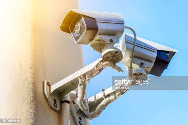 CCTV security camera against blue sky