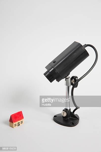 Security camera and model house against white background