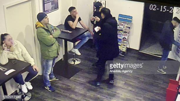 A security camera footage shows Tobias R the gunman who targeted migrants at two cafe bars at the cafe 6 days before the shooting in the western town...