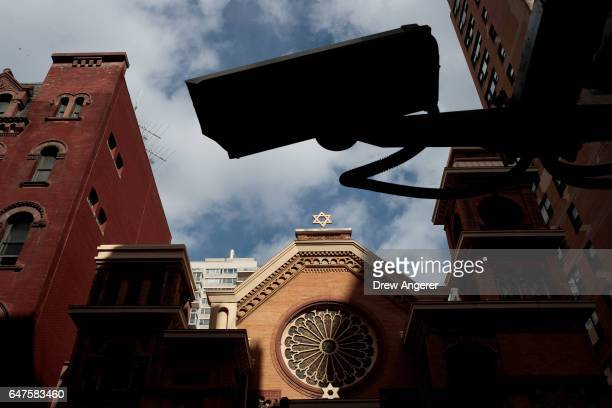 Security camera hangs across the street from the Park East Synagogue March 3 2017 in New York City Earlier on Friday morning in St Louis Federal...