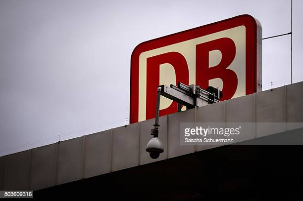 A security camera hangs in front of the logo of the Deutsche Bahn on the Hauptbahnhof main railway station on January 6 2015 in Cologne Germany 90...