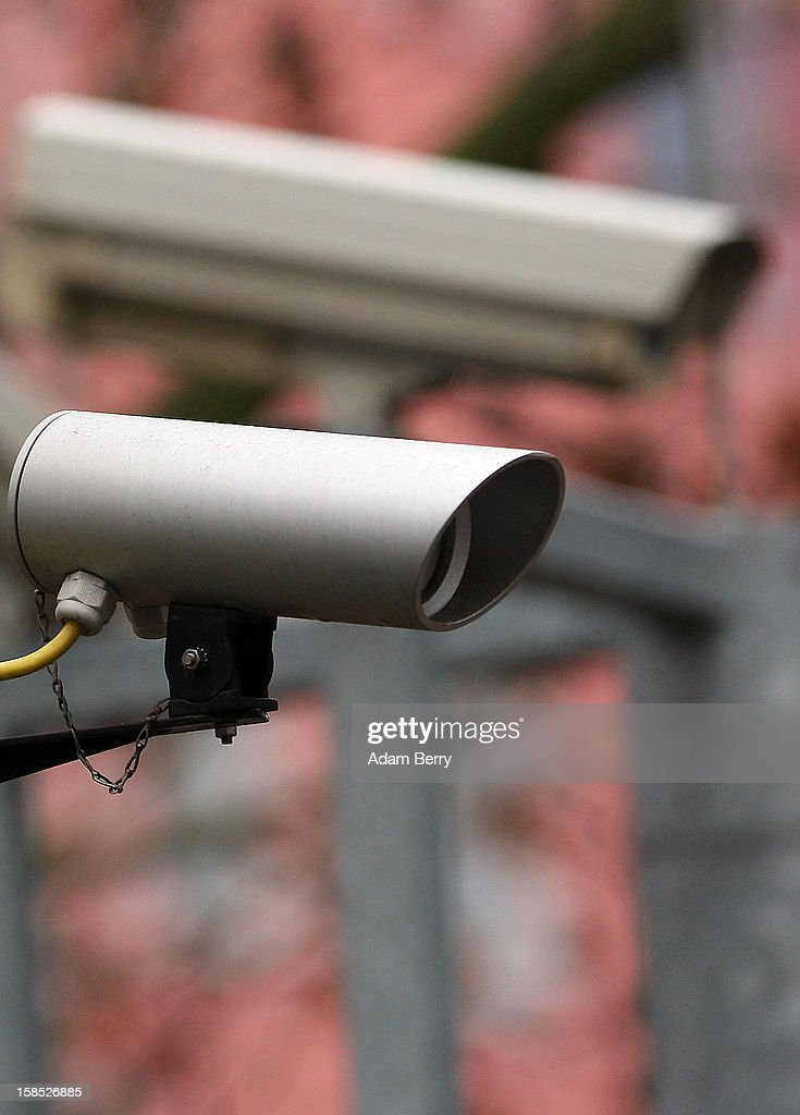 A security camera hangs on the street on December 18, 2012 in Berlin, Germany. After an attempted bombing at the main train station in Bonn, about whose planting on site security cameras were not able to provide sufficient footage as evidence, the German government is discussing increasing its public video surveillance.