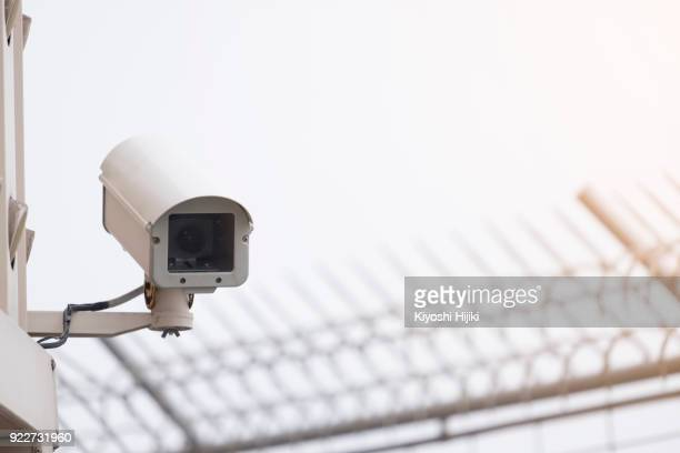 cctv, security camera in city - defending stock photos and pictures