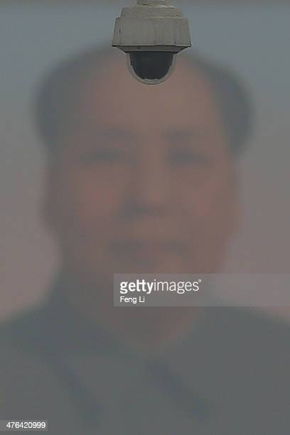 A security camera is seen in front of Mao Zedong's portrait during severe pollution at the Tiananmen Square before the opening of the 2nd session of...