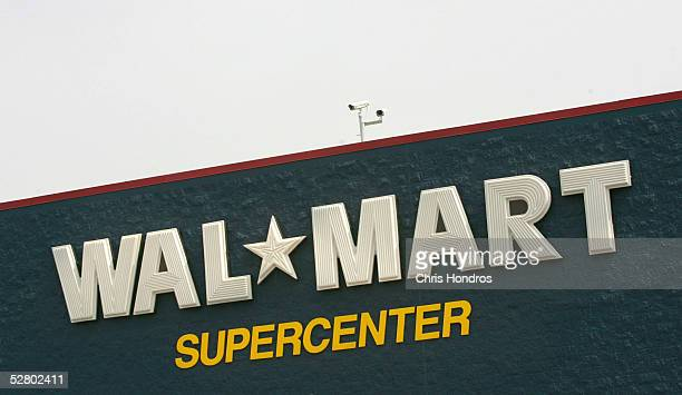 A security camera lies atop a WalMart Supercenter May 11 2005 in Troy Ohio WalMart America's largest retailer and the largest company in the world...