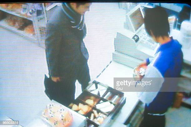 security camera monitor screen - convenience store counter stock photos and pictures