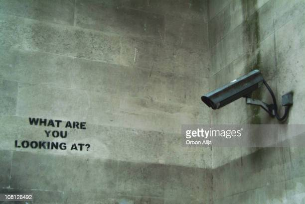 Security Camera Mounted on Wall with Graffiti