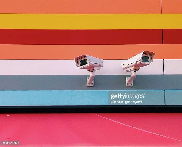 Security Camera On Multi Colored House Wall