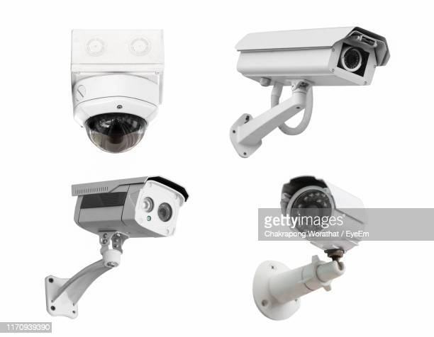 security cameras against white background - surveillance camera stock pictures, royalty-free photos & images