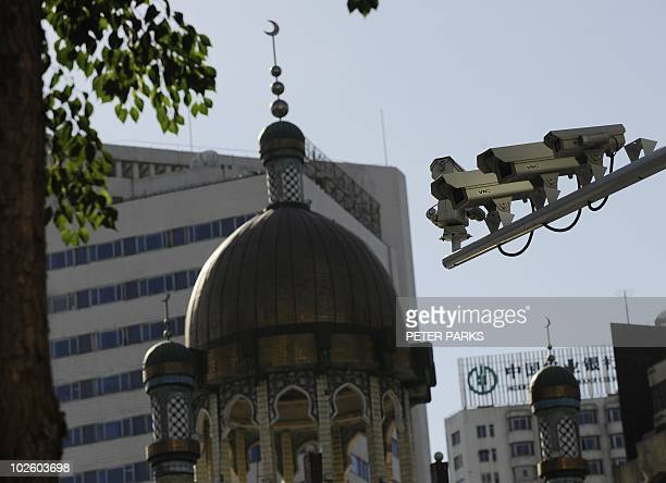 Security cameras are seen on a street in Urumqi capital of China's Xinjiang region on July 2 2010 ahead of the first anniversary of bloody violence...