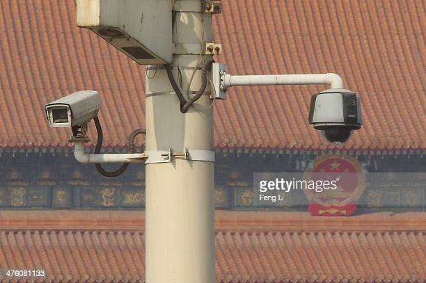 Security cameras hang on a lamp at the Tiananmen Square ahead of the opening of the Chinese People's Political Consultative Conference on March 2...