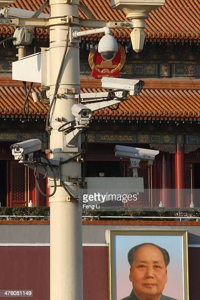 Security cameras hang on a lamp at the Tiananmen Square ahead of the opening of the Chinese People's Political Consultative Conference on March 1...