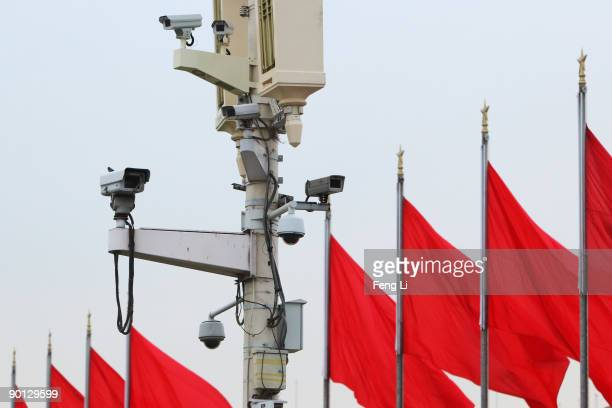 Security cameras hang on a lamp at the Tiananmen Square before a celebration rehearsal for China's 60th anniversary on August 28 2009 in Beijing...