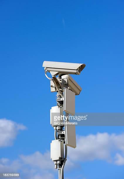 Security Cameras on Blue Sky