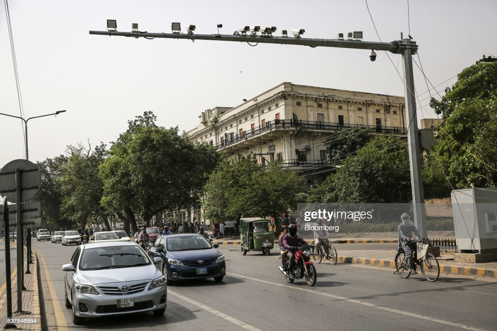 Security cameras operate above a road in Lahore, Pakistan, on Tuesday, June 13, 2017. While militants the U.S. identifies as terrorists find refuge in Pakistan, safety within the nation has improved dramatically after it launched a costly, now four-year long military crackdown on domestic insurgent and criminal groups, driving recent economic optimism. Photographer: Asad Zaidi/Bloomberg via Getty Images