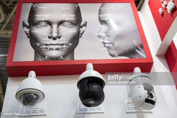 AI security cameras with facial recognition technology are seen at the 14th China International Exhibition on Public Safety and Security at the China...