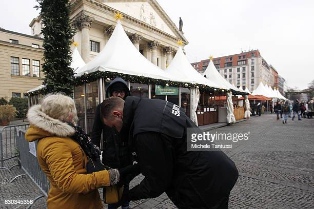 Security check bags at the entrance of a Christmas market at the Gendarmenmarkt the day it reopened following an apparent terror attack on another...