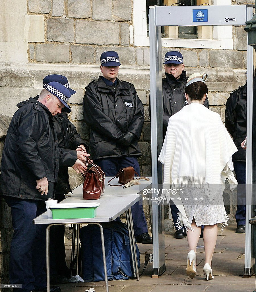 Security check handbags from guests as they arrive for the Service of Prayer and Dedication blessing the marriage of TRH Prince Charles, the Prince of Wales, and Camilla, the Duchess Of Cornwall, at The Guildhall, at Windsor Castle on April 9, 2005 in Berkshire, England.