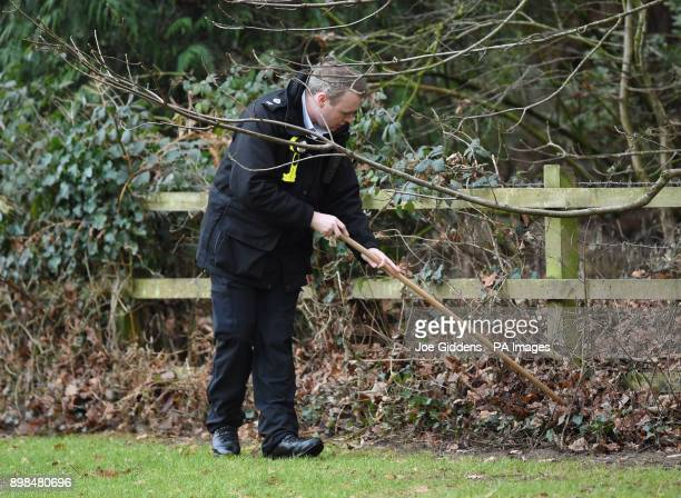 Security check the grounds ahead of members of the Royal family attending the Christmas Day morning church service at St Mary Magdalene Church in...