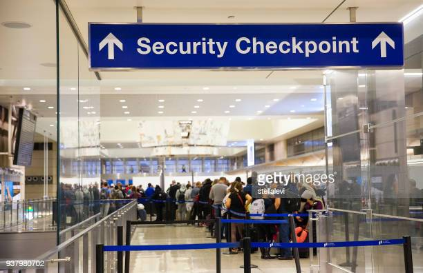 security checkpoint sign at the airport - blocco stradale foto e immagini stock