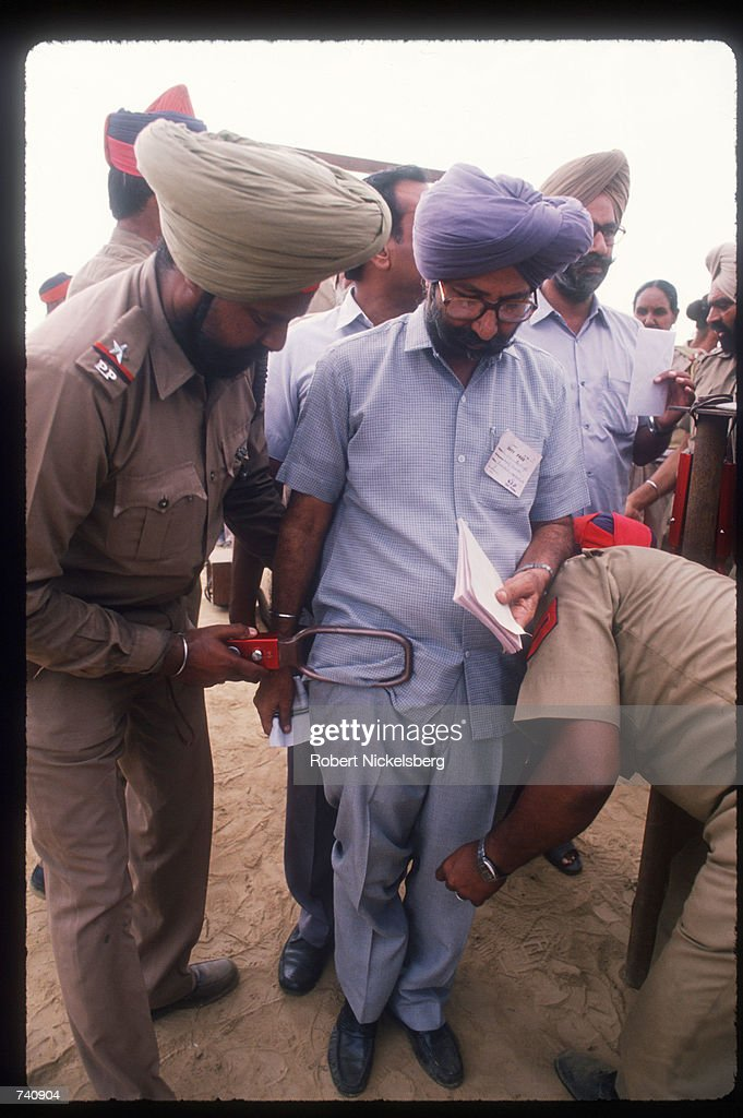 Security checks a Sikh man during Indian Prime Minister Rajiv Gandhi`s visit to the Punjab state September 21 1988 in Punjab India Sikhs who attended.