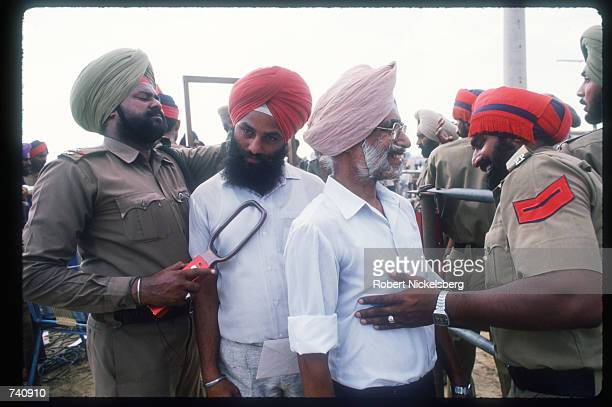 Security checks a Sikh man during Indian Prime Minister Rajiv Gandhi's visit to the Punjab state September 21 1988 in Punjab India Sikhs who attended...