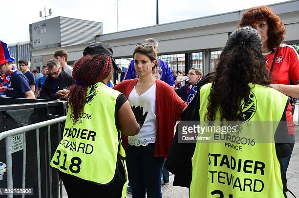 Security checks at the entrance to the stadium before the GroupA preliminary round match between France and Romania at Stade de France on June 10...