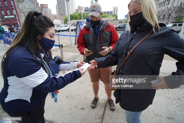Security checks Covid-19 vaccination cards before the game between the Toronto Blue Jays and Miami Marlins at Sahlen Field on June 2, 2021 in...