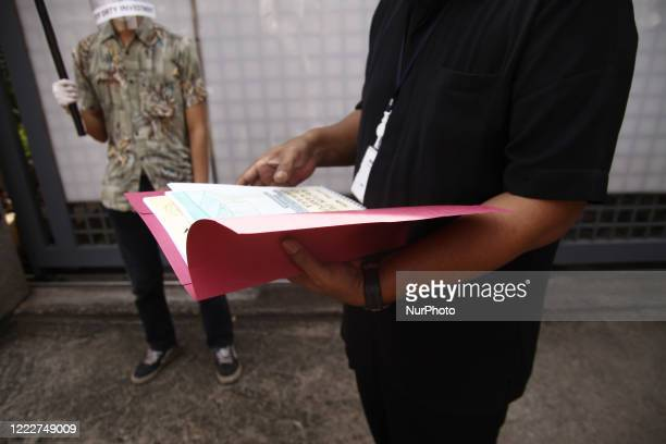 Security cheks documents from environmental activists aimed at South Korean Ambassador Kim Changbeom during the AntiDirty Energy rally in front of...