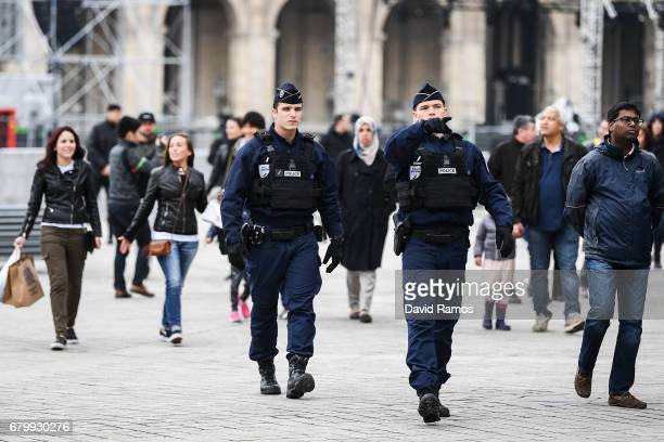 Security clear The Louvre following a bomb scare ahead of Emmanuel Macron's plans to celebrate here later should he win the French election on May 7...