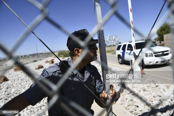 Security close the gate as New York mayor Bill de Blasio approaches the border crossing fence at the Tornillo Port of Entry near El Paso Texas June...