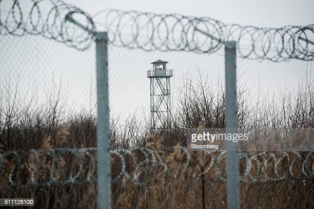 A security control post stands in the field beyond a razor wired topped security fence on the HungarianSerbian border near Roszke Hungary on...